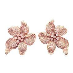 """Twenty carats of exceptional Fancy pink diamonds floral earrings by the famed jewelry designer to the stars, Fred Leighton. Each earring boasts seven of the rarest colored diamonds at its center, with five petals encrusted in additional glistening Fancy pink diamonds. Each clip earring is masterfully crafted of 18K rose gold and signed """"Leighton."""""""
