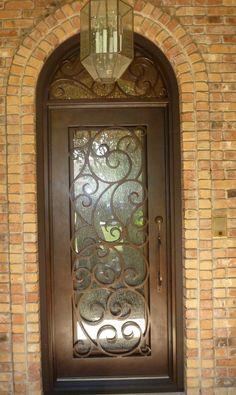 Swirly design single iron door + transom aaleadedglass.com
