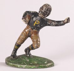 """Football player figural bookend c.1910-15. Cast iron player running with ball retains beautiful polychrome paint with Princeton colors. 5"""" tall. $250"""