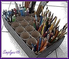 recycled tissue rolls as pencil, pen and paint brush holders... such a great idea for the craft room and the earth as well