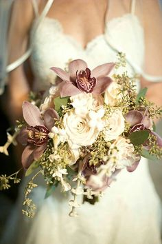 Posh Bridal Bouquet Showcasing: Cream Roses, White Stephanotis, Lavender Cymbidium Orchids + Green Seeded Eucalyptus