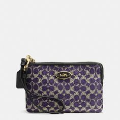 The Small L-zip Wristlet In Signature Coated Canvas from Coach. Unusual color for me but dis is real purdy