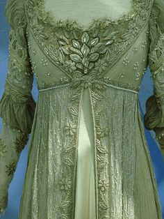 "This gown is Regency inspired, with some 16th century inspiration in the sleeve and neckline area.  Drew Barrymore wears this dress in cream in the movie ""Ever After"" 1998."