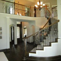 dark floors, light walls, white trim following stairs