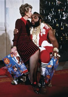 Nancy Reagan on the lap of Mr. T, the famous American actor.