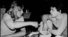 Mick Ronson & Lou Reed share a plate of pasta. ( I'm guessing this is a Mick Rock Photo ) David Bowie sent a letter to the committee of Rock And Roll Hall Of Fame recommending that Mick Ronson should be inducted. - davidbowienews.wordpress.com