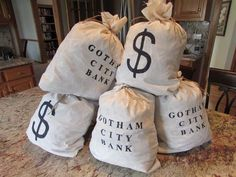 Gotham City Bank money bags - simple sewing project and stencils.  For photo opportunities and villain scenes.