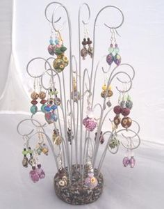 Eye catching earring display made from artistically curved wires in a polymer clay base