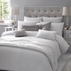 White satin ribbon is embroidered onto crisp white bedlinen and delicate patterns are created inside the ribbons with an intricate embroidered detail. Tiny diamantes are scattered across the embroidery to add some Kylie sparkle.