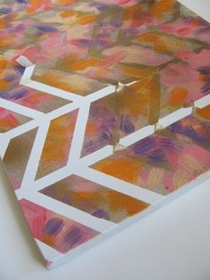 EASY PEASY! Tape, base color, random strokes of other colors (in color scheme), mist spray paint over it