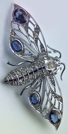 An Art Deco moth brooch, by Weir & Sons, Irish, circa 1930. Silver chromed, faux diamonds and faux sapphires. 7.20 x 3.40 cm. Marks: 'WB' & 'Sterling'. #ArtDeco #brooch #WeirAndSons