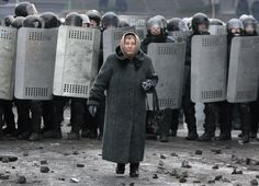Incredibly Badass Photo Of An Old Woman Walking Through The Ukrainian Riots