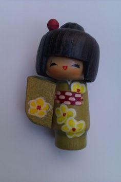 I've never seen a kokeshi doll with limbs... cute.