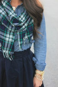 Plaid scarf, skirt, skirt and jewelry...I would probably do a plain scarf