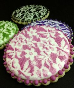 Airbrushed Lace Cookie Tutorial ~ They're beautiful and do not take a lot of time to make.  A lace pattern also also serves as a great great background for monograms, silhouettes and other lettering.
