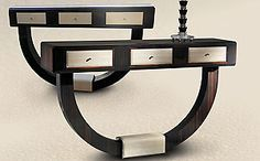 Taylor Llorene | A highly stylised Art Deco inspired highly figured macassar ebony console table with details in first grade highly specified eel leather. http://modernconsoletables.net