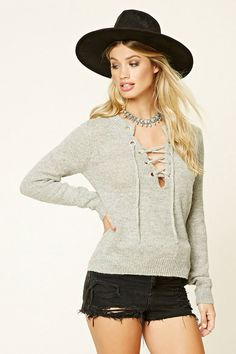 24b4667a8b A marled knit sweater top featuring a lace-up V-neckline