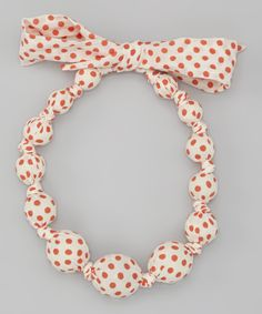 Cover wooden beads in desired fabrics and make necklace...or just buy one on Zulilly already made $10.99, sooo cute!