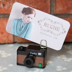 worth a thousand words camera card stand