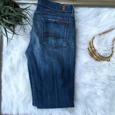 """Final Price❤️ 7 for all Mankind boot cut jeans 7 for all Mankind boot cut jeans! Back is a little worn.... Price reflects. Still have many years left! Inseam 30"""" 7 for all Mankind Jeans Boot Cut"""