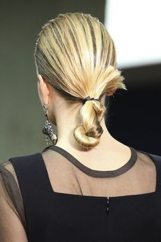 Straight and sleek: An easy low, twisted chignon on the Celine F/W 2014 runway.