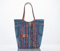 upcycled denim blue jeans and embroidered chico's jacket make this tote.
