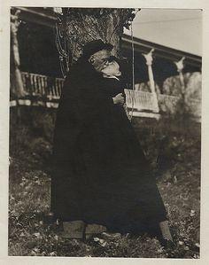 photograph of Georgia O'Keeffe and Alfred Stieglitz kissing at Lake George
