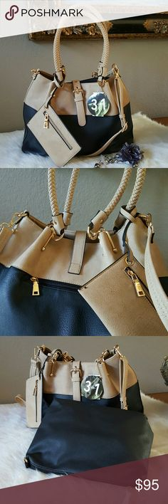 Rivet Faux Leather 3-1 Carry All Tote •NWT. Wilsons Leather exclusive faux leather 3-in-1 carry all tote. •Dual rope handles in a tight weave. •Two- tone color black/tan; gold- tone hardware; removable pouch tassel/Wristlet. •Top buckle strap with magnetic snap closure; additional top zipper closure. •Interior includes removable, snap-in zipper pouch; zipper pocket; 2 open accessory pockets. •Rear zip across pocket.  •Fully lined. •4 metal support studs on bottom. •Wristlet has a mini black…