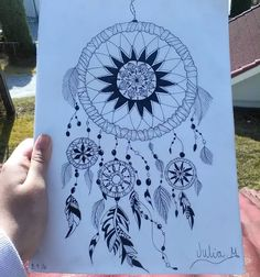 Finally! I am finally done with this dreamcatcher and I must say that I am pretty happy with the result and I hope you are as well! . . . . . . . . . . . . . . . . . . . . . . . . #dream#catch#dreamcatcher#black#white#mandala#blackmandala#drawing#drawings#rainbow#feather#pencil#pen#deawing#blackandwhite