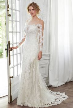 Brides: Maggie Sottero. More details from Maggie Sottero��Corded embroidered lace appliqu�s lay atop illusion sleeves in this sheath gown, complete with illusion bateau over plunging sweetheart neckline and dramatic V-back. Finished with covered button over zipper back closure.