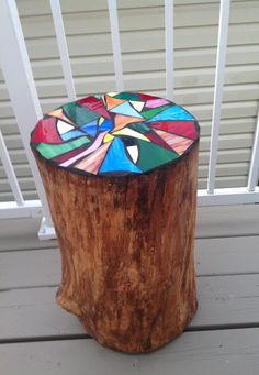 mosaic on top of a stump,love this idea.