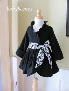 LOVE the ruffle neck- so classy for a little girl's dress