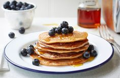 Wake up to these fruity pancakes, best served with a drizzle of maple syrup and fresh berries. Find this easy vegan banana pancake recipe at Tesco Real Food. Healthy Pancake Syrup, Vegan Pancake Recipes, Vegan Recipes, Breakfast Healthy, Breakfast Recipes, Eggless Banana Pancakes, Vegan Pancakes, Banana Flour, Coconut Pancakes