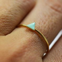 1 Tiny triangle ring- dainty ring- stackable ring- mini geometric ring. $35.00, via Etsy.