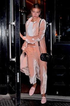 a81a8237b04f Model Hailey Baldwin put together a trendy look  a crushed-velvet  millennial pink outfit and open-backed Gucci loafers in the same shade.
