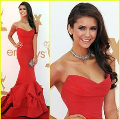 Nina Dobrev looking stunning as usual at the 2011 Emmy's in a strapless red mermaid dress with an open back. Dress designer??? Donna Karan of course.