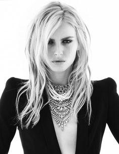 Tom Binns...love the crystal necklace, padded shoulders, black dress, blonde hair look!