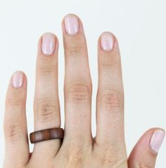 Add some natural texture to your ring collection with this charming wooden ring!