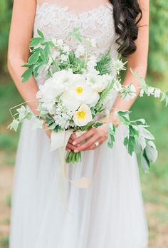 Brides.com: . A loose bouquet comprised of anemones, bleeding heart, stock, and greenery, created by The Farmer's Daughter.