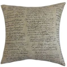 "Cotton throw pillow with a script motif and feather-down fill.   Product: PillowConstruction Material: Cotton cover and 95/5 down fillColor: Graphite and naturalFeatures:  Insert includedHidden zipper closureMade in the USA Dimensions: 18"" x 18"" Cleaning and Care: Spot clean"