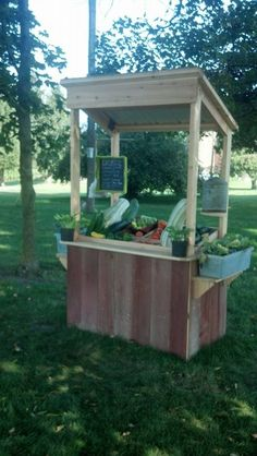 Rustic roadside vegetable stand with honor box made from a antique chicken waterer.
