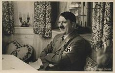 A smiling Adolf Hitler poses for a photo, and it captures his heart shaped…