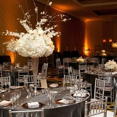 Reception tables were topped with silver linens and tall white arrangements of orchids, hydrangeas and roses. Victoria Clausen Florals and Event Design @Victoria Clausen Florals