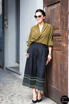 TREND: Culottes - Tina Leung pairs hers with a silk wrap-front blouse and fierce cat-eye shades for an extra pinch of pizzazz  | Styloko.com
