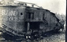 """One of the most photographed tanks of the war """"Blarney Castle"""", a Mk IV 'female' sits where it was knocked-out by truck-borne German artillery in Fontaine Notre Dame, about 4 kilometres West of Cambrai. The entrance hole of the armour-piercing round that turned the tank's interior into an inferno, can be seen just forward of the port sponson.    The British tanks suffered 70% casualties during the ill-fated attack on Fontaine-Notre-Dame on 23 November largely thanks to the accuracy of the…"""