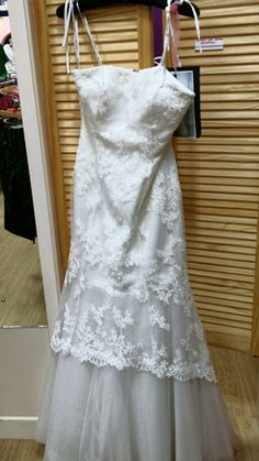 Size 10 Strapless Wedding Dress with Lace Detail from Mind Charity Shop in Harrow.