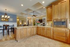 Gorgeous open concept home with custom cabinets and coffered ceilings.  #CofferedCeiling #WaffleCeiling, AccentHaus.com