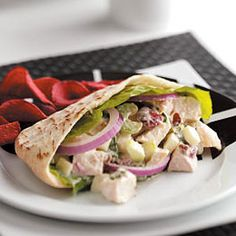 Fruited Turkey Salad Pitas Recipe from Taste of Home -- Leftover turkey gets a great makeover with this tasty spread that feeds a crowd. Shared by Donna Noel of Gray, ME  #turkey  #leftovers