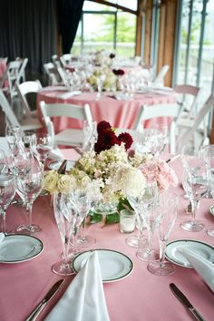 Tone down the colors of your wedding by adding white florals and china.