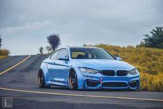 BMW F82 M4 blue widebody slammed